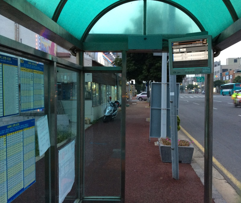 Bus stop with the monitor showing how much time one should wait before the bus arrives