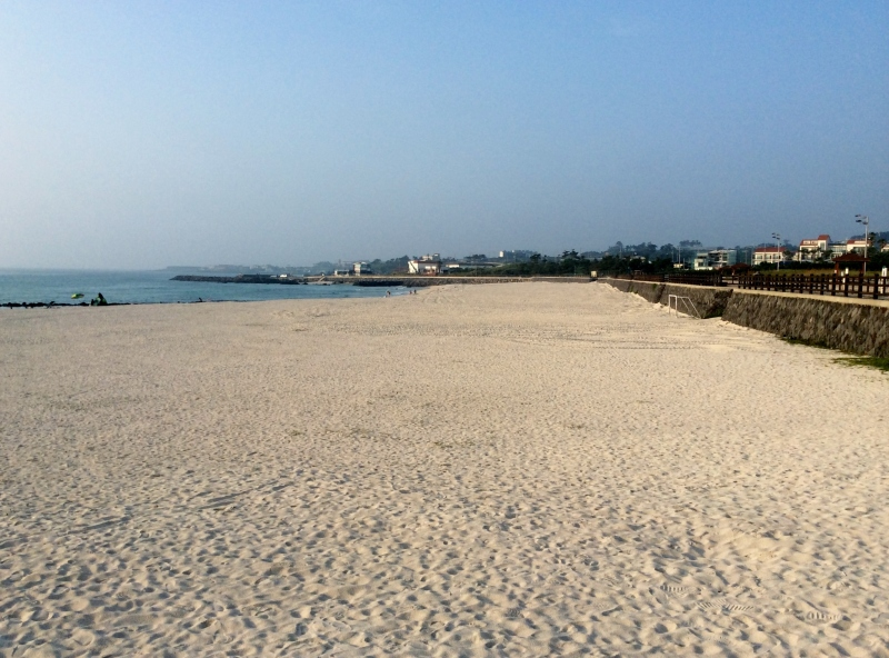 Miles of sandy beach could be seen at Gwakji